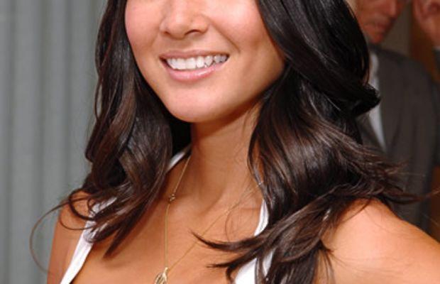 Olivia Munn's shiny dark brown hair.