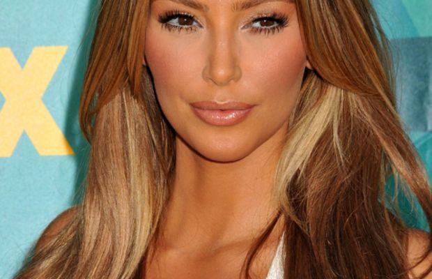 Kim Kardashian faux tan blonde hair