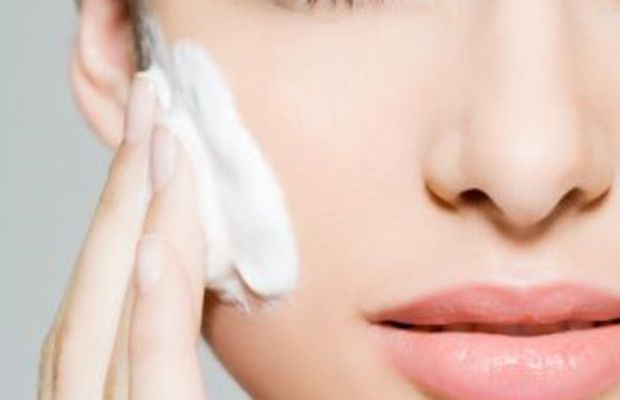 woman-applying-skincare