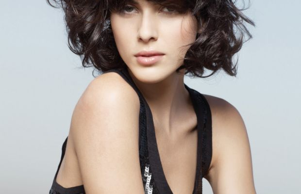 Curly brunette bob with bangs