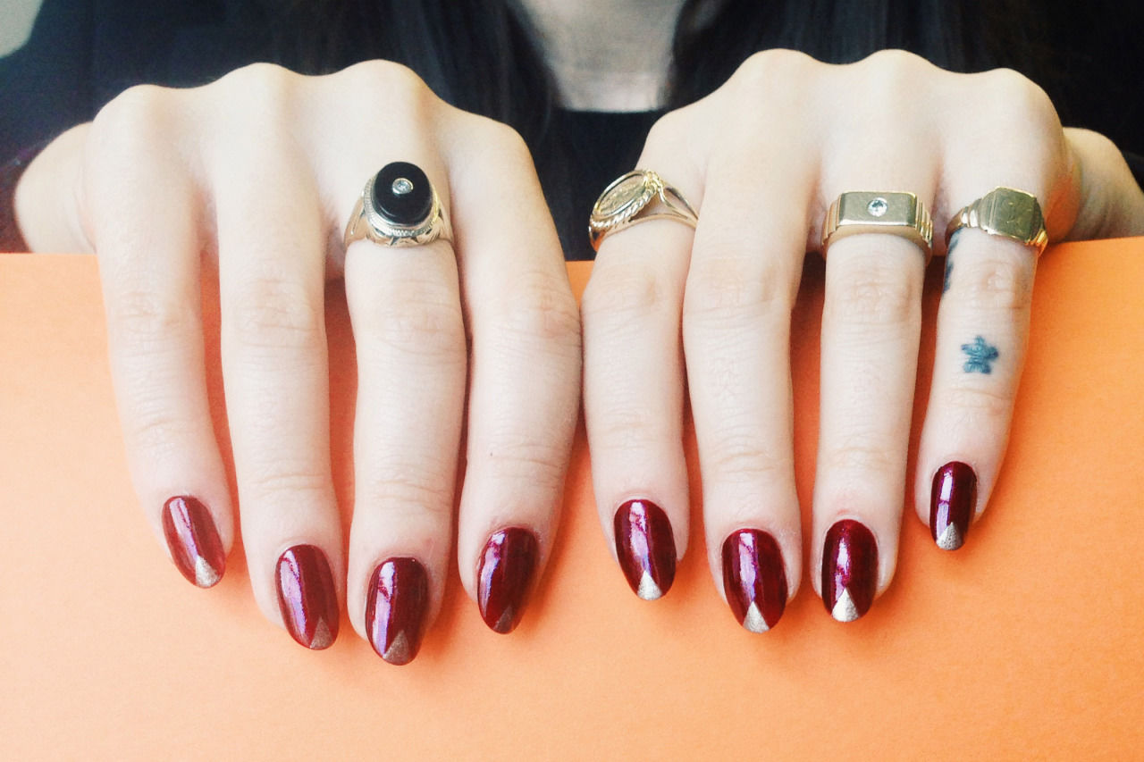 Madeline Poole metallic red nails