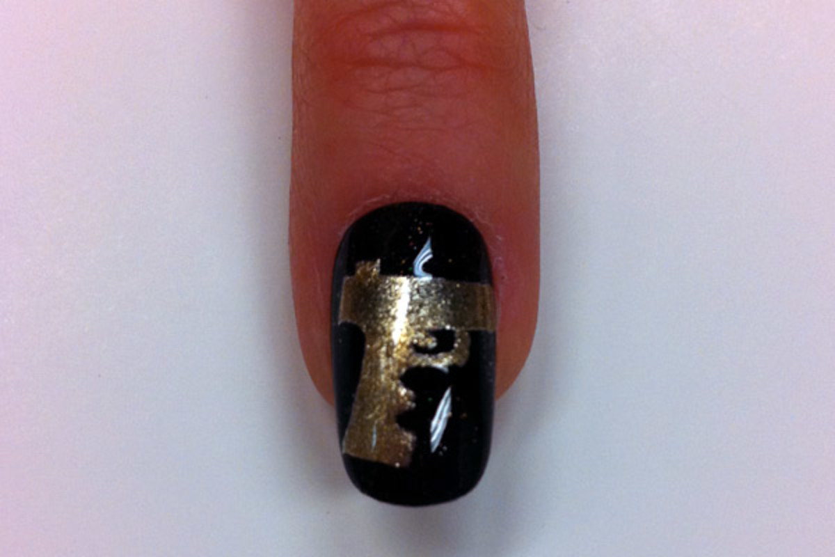 Bond girl nail art by Sally Hansen - gun