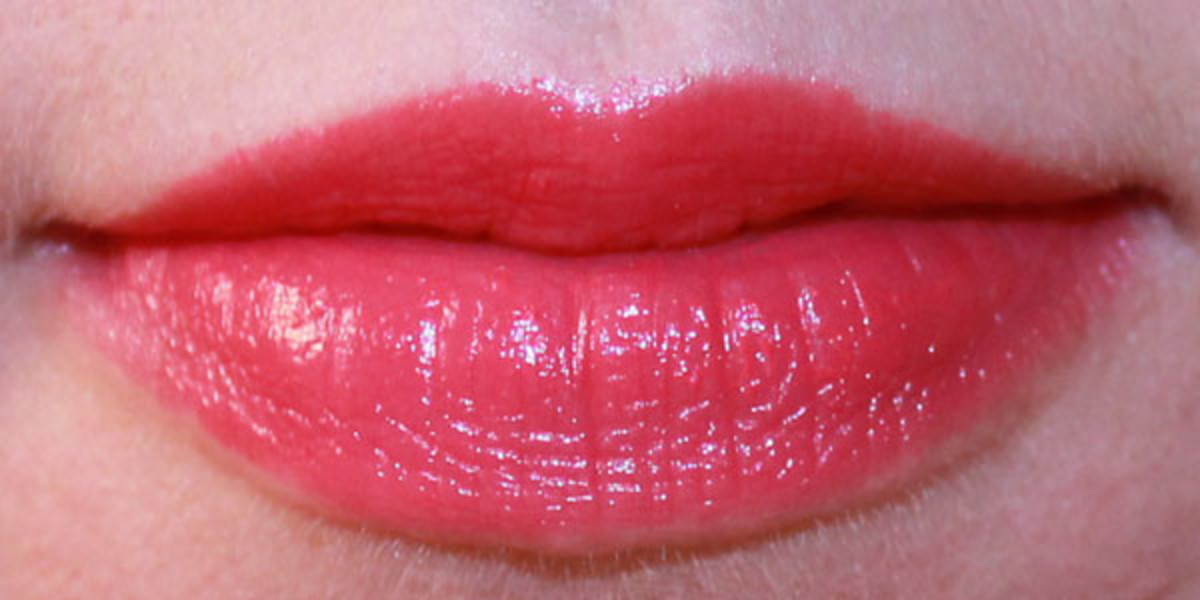 Guerlain Rouge Automatique Hydrating Long-Lasting Lip Colour in 144 Insolence (on lips)