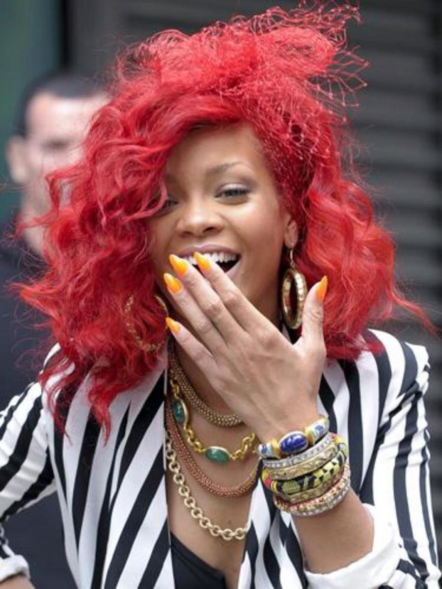 Rihanna yellow stiletto nails