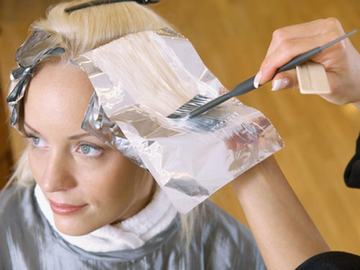 Woman getting hair coloured