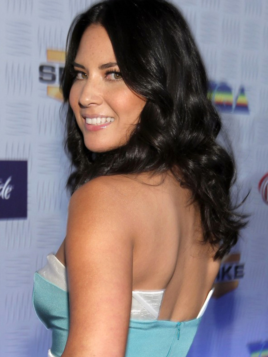 How to wear shimmer and glitter the grown up way beautyeditor olivia munn shimmer shoulders ccuart Images