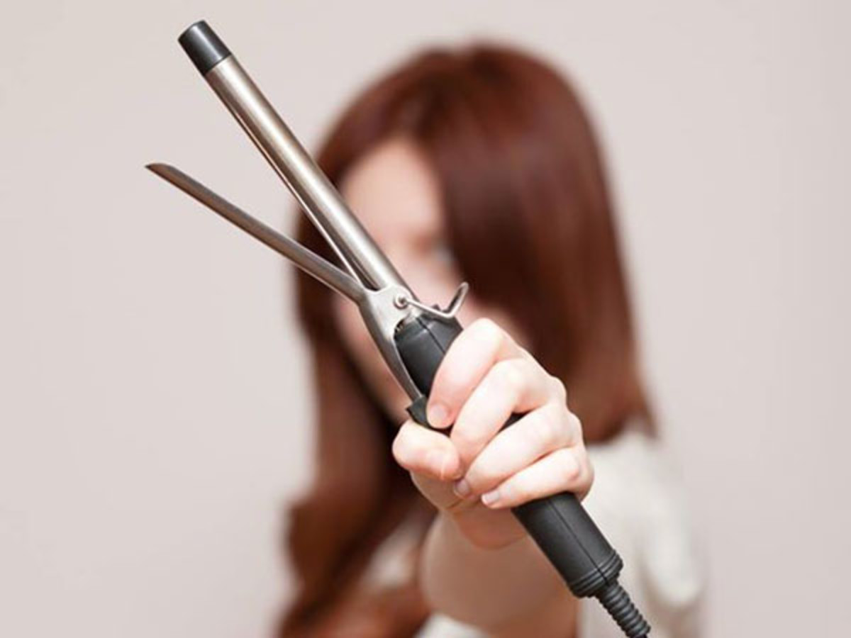 Woman holding curling iron