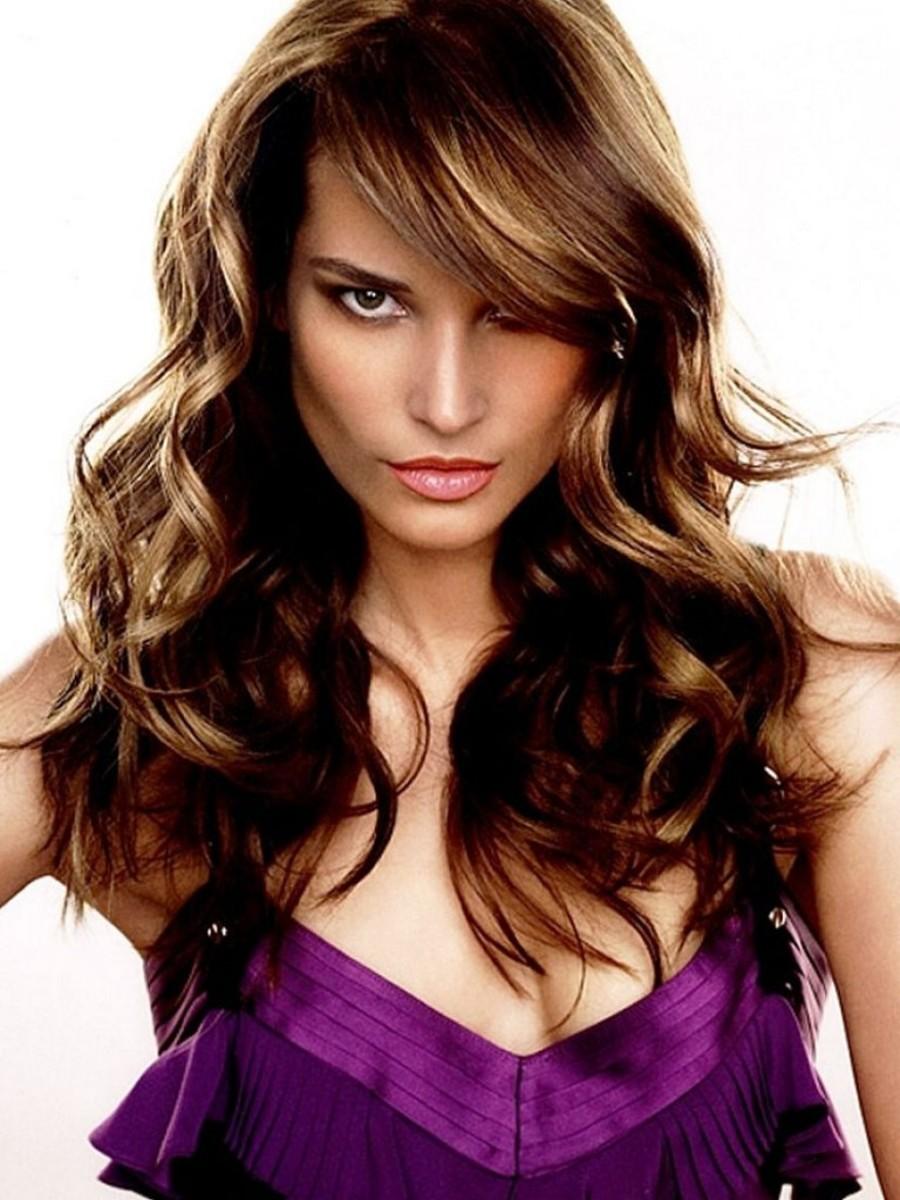 Long wavy brown hair with side bangs