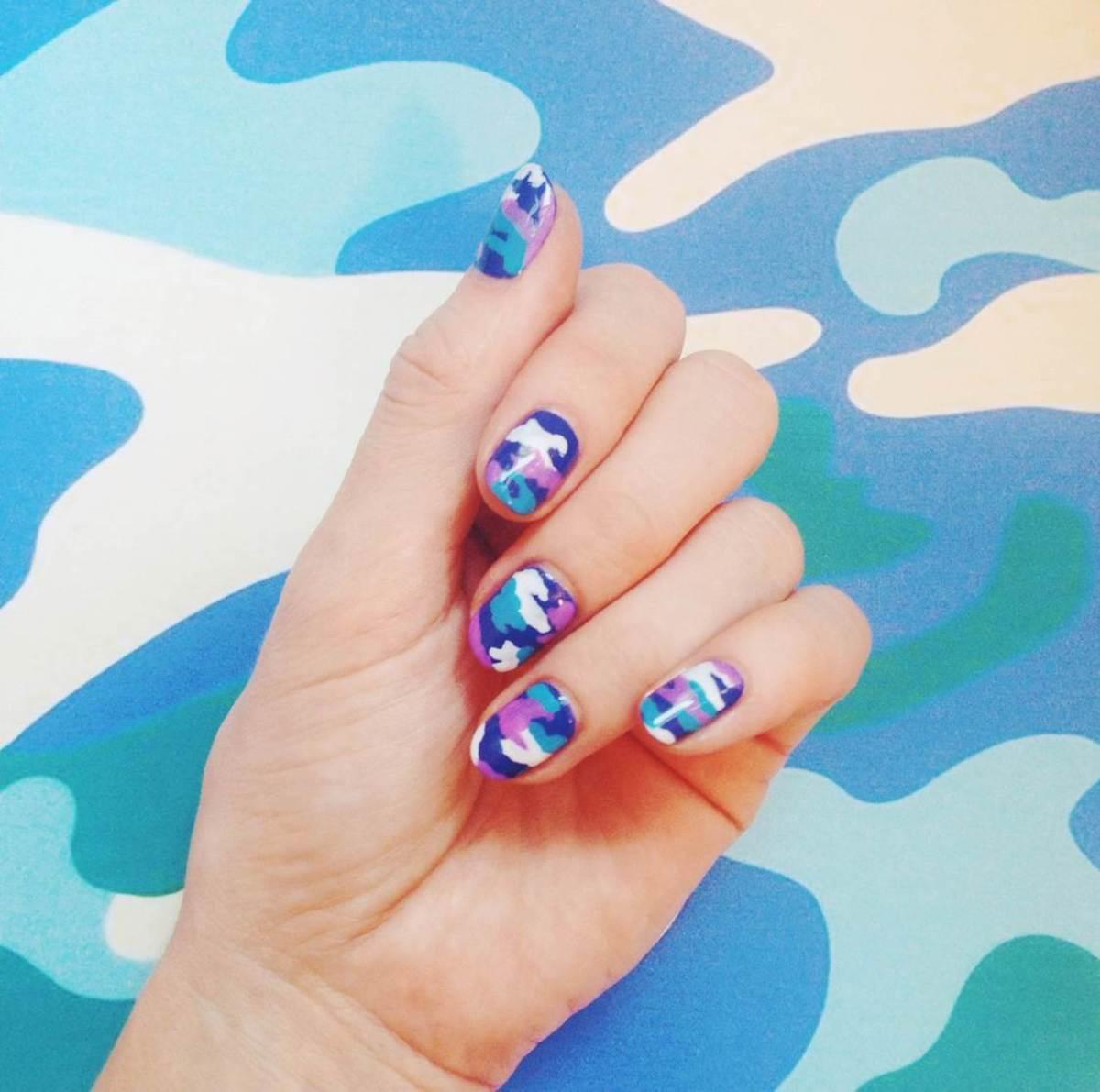Madeline Poole blue camouflage nails