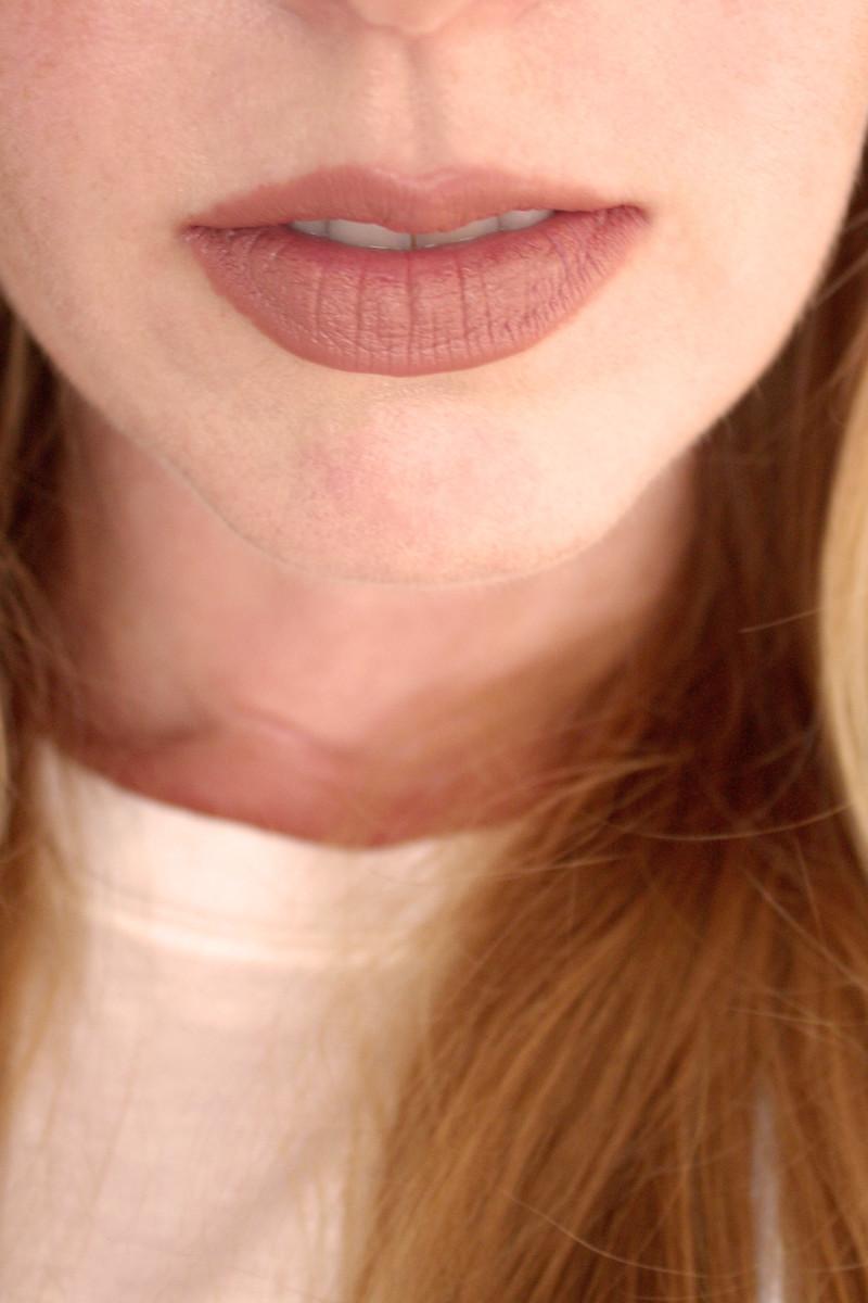 Bite Beauty Multistick in Cashew (on lips)